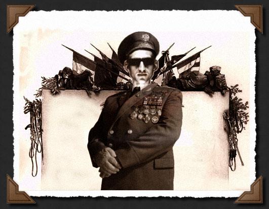 Le résidictateur devant le monument aux mort des guerres barbudiennes